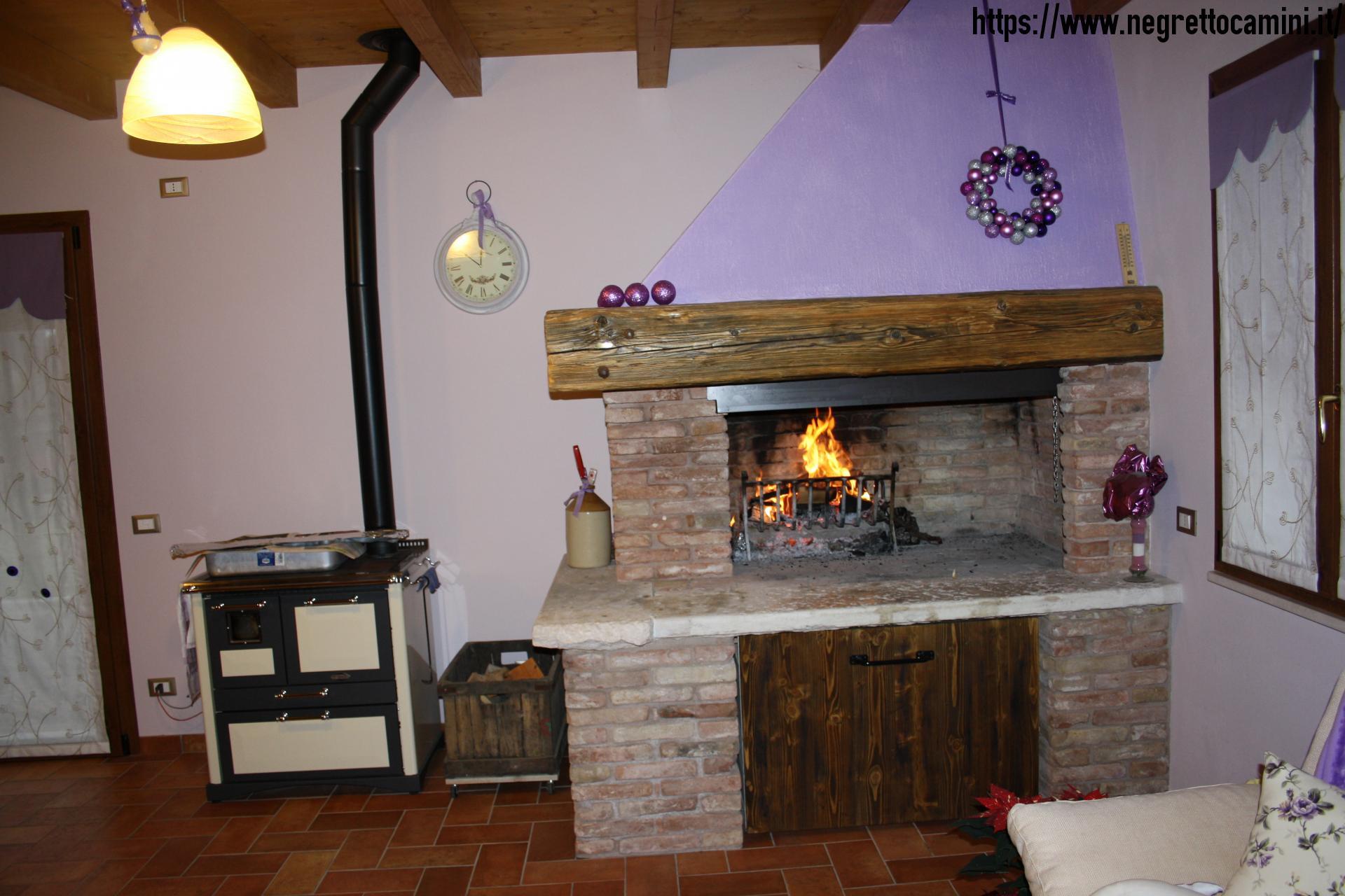 Camino rustico da taverna negretto camini d 39 autore for Foto di taverne arredate
